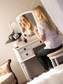Beautiful Blonde Woman Brushing Hair Bedroom Vanity Natural Beauty