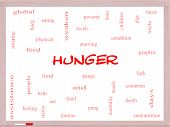 stock photo of starving  - Hunger Word Cloud Concept on a Whiteboard with great terms such as food pangs starving and more - JPG