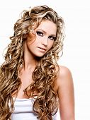 Beautiful woman with luxury blond long curly hair