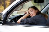 beautiful young  woman sleeps in the car  - outdoors