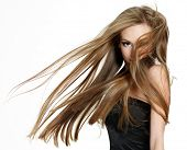 image of hair motion  - Beautiful teen girl shaking head with long hair on white background - JPG