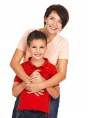 Full portrait of a happy young mother with son 8 year old over white background