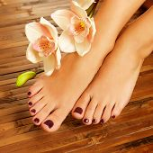 Closeup photo of a female feet at spa salon on pedicure procedure - Soft focus image