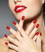 stock photo of lip  - Young woman with fashion red nails and sensual lips  - JPG