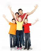 stock photo of bonding  - Happy family with raised hands up isolated on white background - JPG