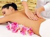 Woman on healthy massage of body in the spa salon. Beauty treatment concept.