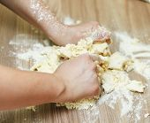 Kneading Dough On The Kitchen Table