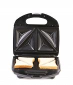 Sandwich toaster with bread slices.