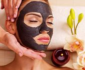 stock photo of female mask  - Cosmetologist doing massage on the woman - JPG