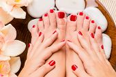 pic of pedicure  - Closeup photo of a beautiful female feet at spa salon on pedicure procedure - JPG