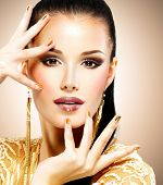 pic of minx  - Portrait of the beautiful fashion woman with black makeup and golden manicure - JPG