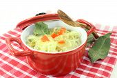 image of cruciferous  - fresh cabbage with carrots and bay leaf - JPG