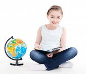 Portrait of a cute little girl with a globe - isolated on white.