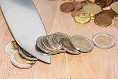 Knife Cutting Euro Coins