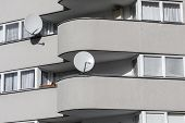 Detail Of A Sparse Gray House With Two  Satellite Dishes
