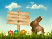 Chocolate bunny with easter eggs and a sign in a field. Vector.