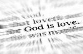 stock photo of worship  - Detail closeup zoom God is love scripture in bible verse - JPG