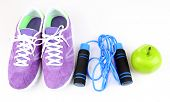 Sneakers and sport equipment. Conceptual photo of fitness progress. Isolated on white