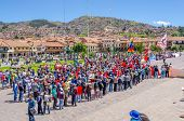 CUZCO, PERU, MAY 1, 2014:  Policemen and policewomen in tactical vests and special equipment control the 1 May manifestation in Plaza de Armas