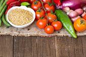 Raw Organic Bulgur In Bowl And Vegetables