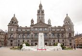 Glasgow, Scotland, UK - 23 August 2014: George Square Cenotaph monument to the victims of first World War in Glasgow (some people in background).
