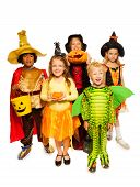 Kids with pumpkin and in Halloween costumes