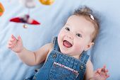Sweetest Baby Girl Playing With A Colorful Mobile Toy