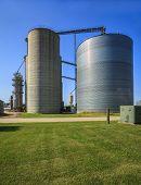 Silver, shiny agricultural silos.