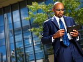 cool professional business executive with tablet