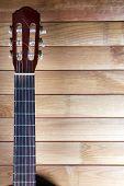Guitar fretboard on wooden background