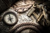 vintage  still life with compass,sextant and old map.map used for background is in Public domain. Ma