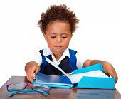 Little boy reading books, portrait of sweet African American kid isolated on white background, preparation to go to first grade, back to school concept