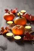 decorative halloween pumpkins and candles
