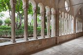 DUBROVNIK, CROATIA - MAY 26, 2014: Hallway around famous courtyard in the Monastery of the Friars mi