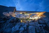 DUBROVNIK, CROATIA - MAY 27, 2014: Buza beach cafe at night. It is one of the most beautiful bars in Dubrovnik which is hanged on the cliffs right above the sea, with an amazing view of the Adriatic.
