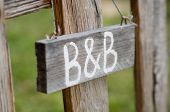 stock photo of bed breakfast  - Closeup Of Old Signboard Bed  - JPG