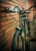 Vintage bicycle against a brick wall