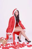 Young woman in lingerie and coat with hat of Santa Claus