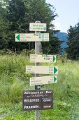 COL DE VOZA, FRANCE - AUGUST 24: Tour du Mont Blanc direction signs. The popular tour goes through F