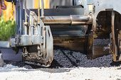 stock photo of heavy equipment operator  - Heavy machiners construction works during asphalting road - JPG