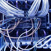 stock photo of utp  - rack in the data center with working equipment with optical and UTP cables - JPG