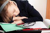 Blond Caucasian Schoolgirl Sleeps On The Desk In School