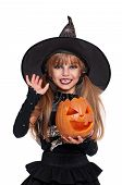 stock photo of warlock  - Portrait of little girl in black hat with pumpkin isolated on white background - JPG