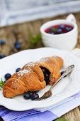 Fresh homemade french croissants with blueberries