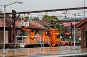 Rail maintenance gang fix overhead lines