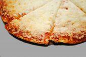Slices Of Mozzarella Pizza Over A Gray Background