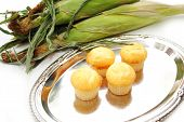 Four Delicious Corn Muffins On A Siver Platter