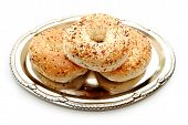 Three Stacked Everything Bagels On A Platter