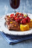 Pork ribs with roasted cherry tomatoes and sweetcorn