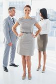 Businesswoman standing beside other employees at work